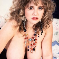 Stunner with curly hair Tracy West sets her irresistible boobs free of tempting lingerie