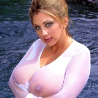Solo model Autumn Jade shows off her huge boobies in a figure of water in see-thru attire