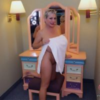 Solo model Claudia Marie displays her huge boobies while on a bed and in a tub