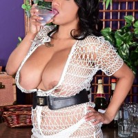 Solo model Danni Lynne whips out her monster-sized breasts over a gulp in g-string undies