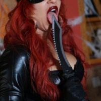 Solo model Karen Fisher looses her monster-sized tits and ass from spandex attire at Halloween