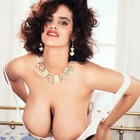 Solo model Nilli Willis captures her big breasts in milky hosiery and garters
