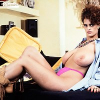 Solo model Nilli Willis holds her massive fun bags after unveiling her unshaven pussy