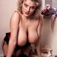Solo model Suzanne Brecht lets out her knockers and butt from beguiling lingerie in washroom