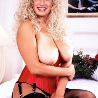 Solo model Taylor Marie holds her hefty funbags in a midbody cincher and garters with nylons
