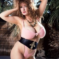 Solo adult film starlet Jessica Fun bags bares her large boobs from swimsuit by a swimming pool