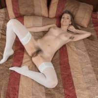 Stocking and high heel outfitted dark-haired amateur opening up hairy vag