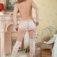 Stocking and lingerie outfitted Euro first-timer exposing unshaven cooch