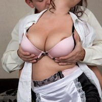 Stocking and uniformed clad maid having hefty all natural melons exposed for nipple play