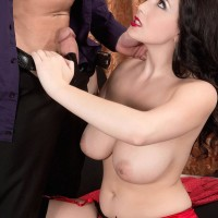 Stocking clad brown-haired X-rated film star Noelle Easton unleashing uber-cute funbags from lingerie