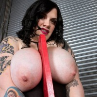 Tattooed BIG HOT LADY Marilyn Mayson flaunting large boobs and large ass in ebony boots