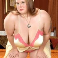 Tatted BIG HOT WOMAN Miss Isabelle strips off her satin lingerie and panties in solo action