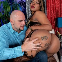 Tattooed ebony female Diamond Monroe dirty dances her big butt on a tabouret for a milky stud
