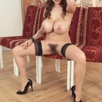 Inked solo model Mischel Lee revealing humungous breasts and losing grandmother panties
