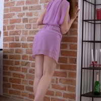 Teenage amateur Tina unsheathes her upskirt panties after showing her small boobies by herself