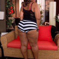 Chubber ebony dame Lareina displays her her huge elastic butt in a g-string and high-heels