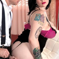Fatty brown-haired solo girl Scarlet LaVey flashing tattoos in lingerie and stockings