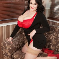 Fatty black-haired solo model Lila Payne poses in a crimson boulder-holder and tan tights on couch