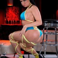 Plumper black solo chick Nikki Delano showcasing spectacular ass before loosing gigantic juggs