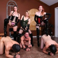 3 domineering type gals screw male slaves in the mouth and booty with strap-on cocks