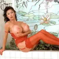 Top Oriental pornostar Minka loosing her massive titties from brassiere garmented crimson hosiery
