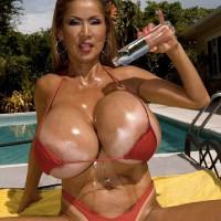 Top heavy Chinese solo female Minka lubricating huge bikini garmented boobies outdoors by pool
