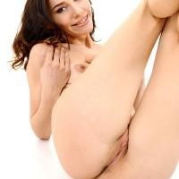 Ukrainian solo chick Adel Morel toys her smooth-shaven vagina after stripping naked