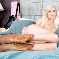 Youthful ash-blonde female Halle Von unveils her diminutive breasts outfitted cowgirl boots