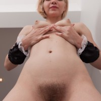 Youthfull European platinum-blonde Baibira letting out fur covered pussy from maid uniform in high heeled shoes